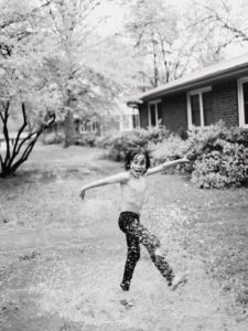 kid playing outside, demonstrating the power of inner child work