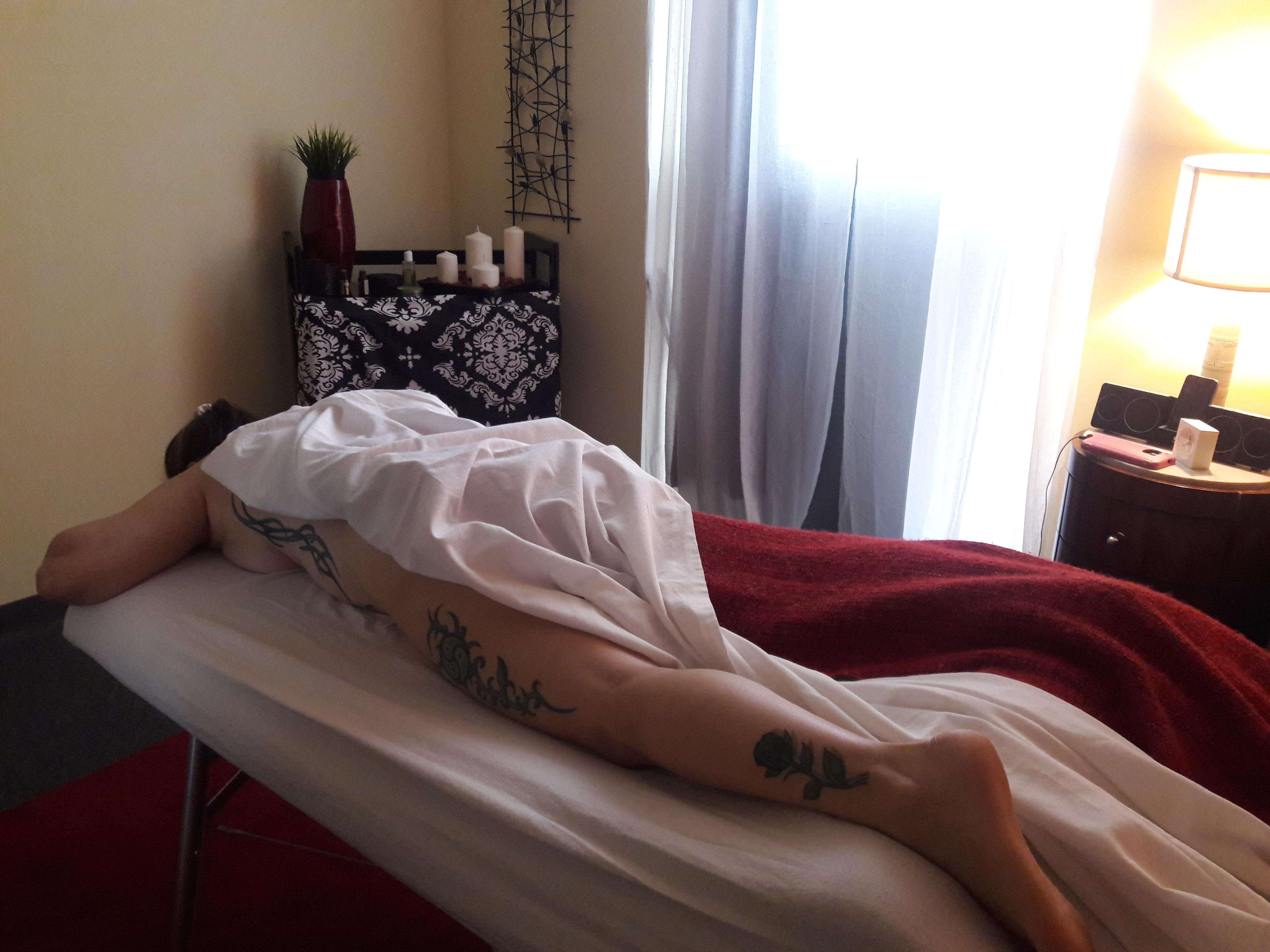 man lying on massage bed, massage and pain management services, Pembroke Pines, Florida