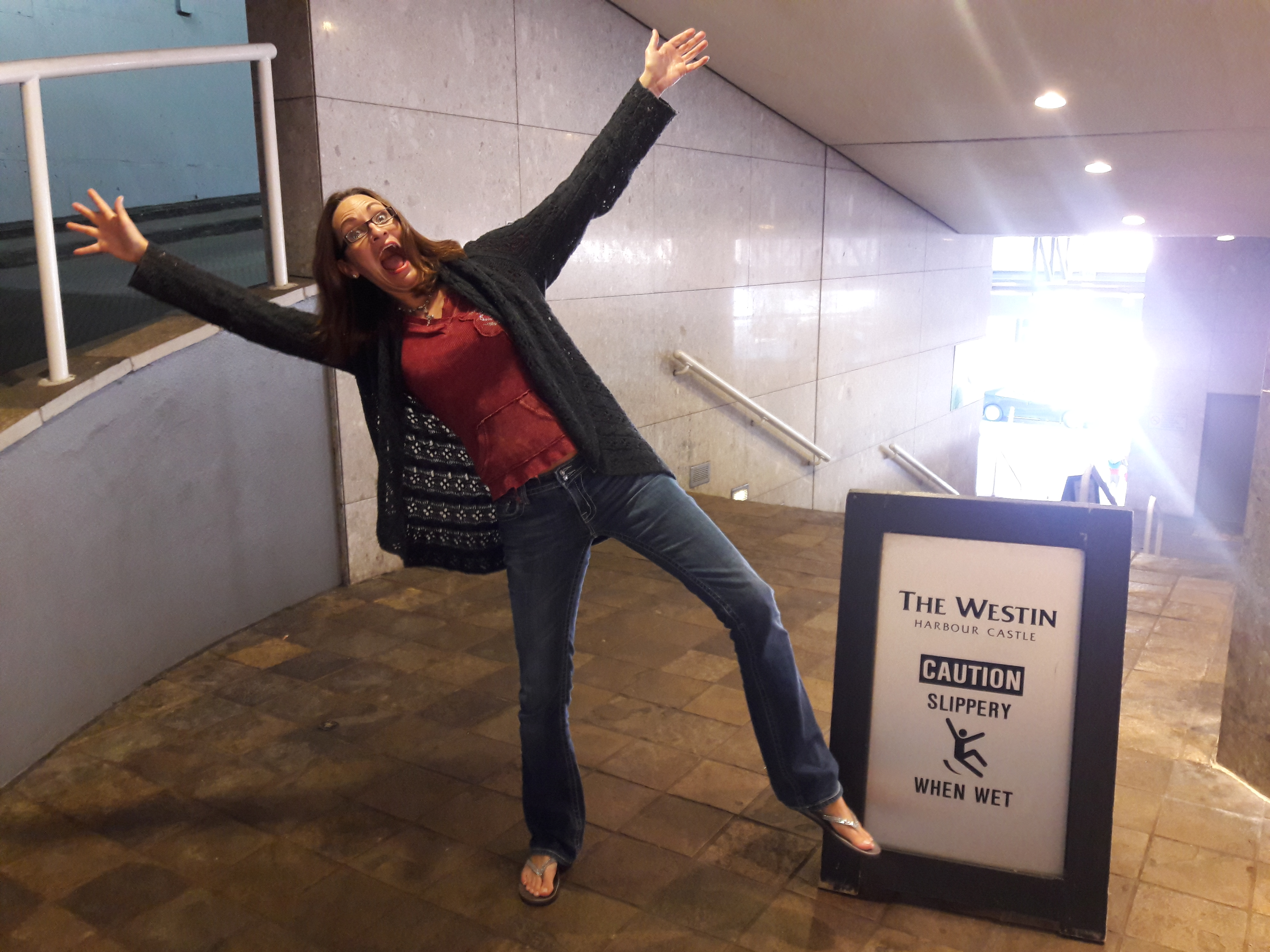 Heather Hundhausen joking about to fall on a wet floor, symbolizing the needed inspiration to hold life light through loving yourself quotes