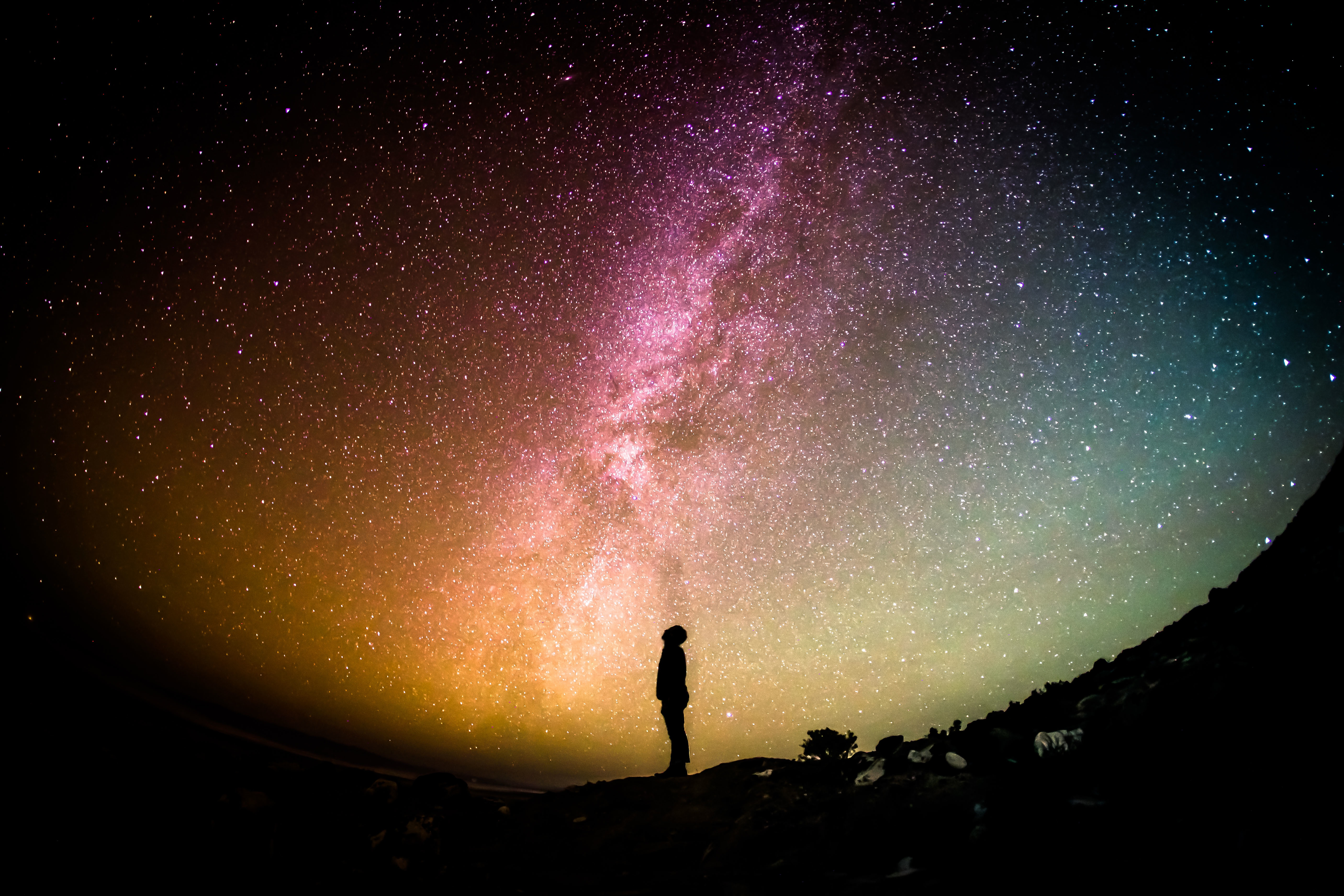 person looking into the night sky, symbolizing the power of your mind