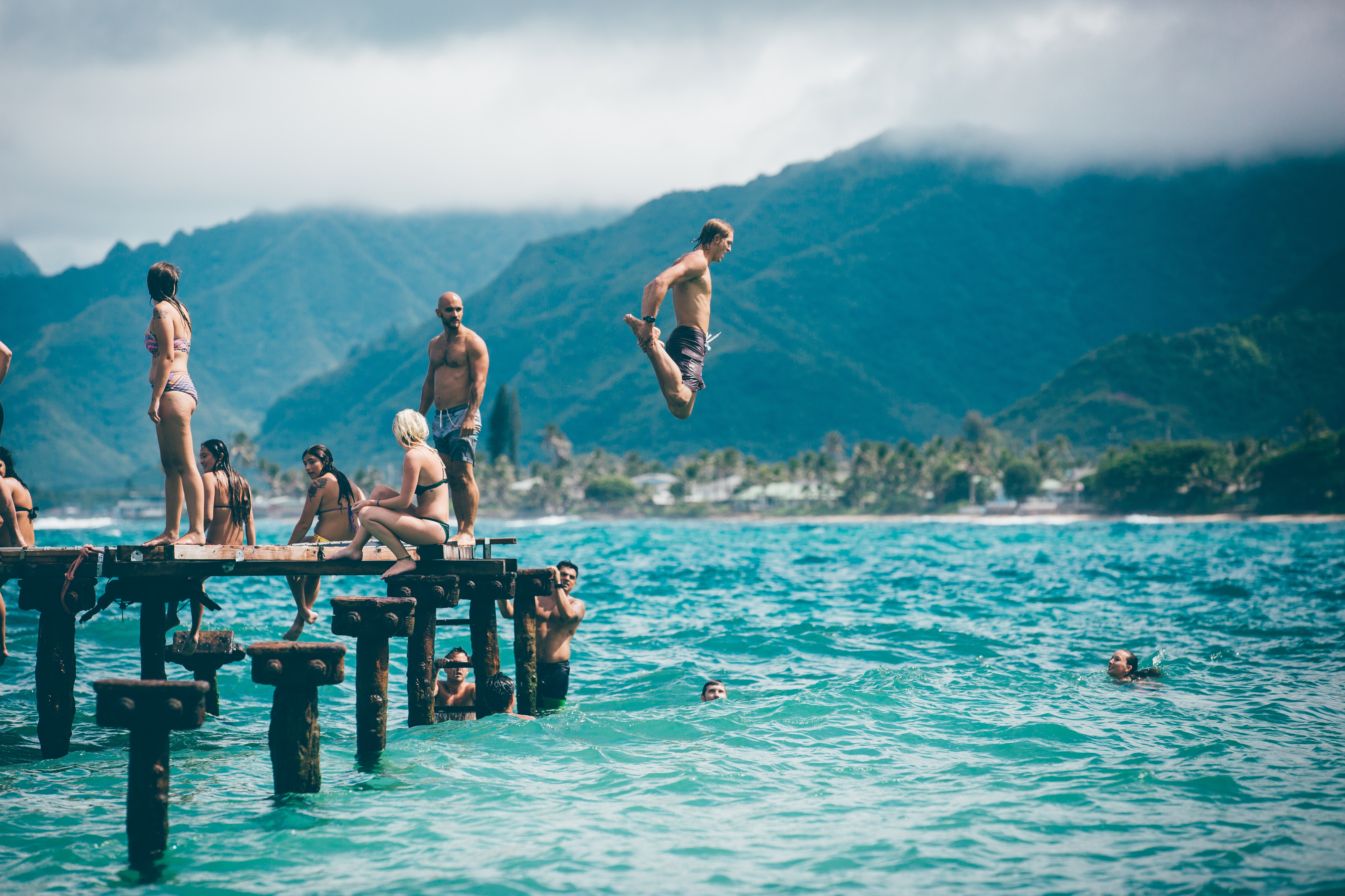 people jumping in a lake and having a good time, you need a structural re-alignment to feel good and healthy