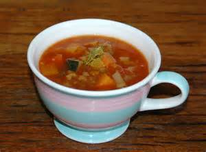 porcellan cup with vegetable soup, part of Heather's master cleanse