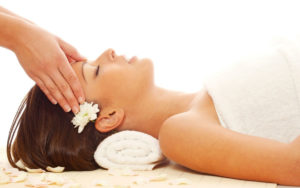 woman laying down for a CranioSacral therapy (CST) massage