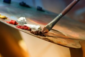 a palette with paint for a painting, CranioSacral therapy (CST)