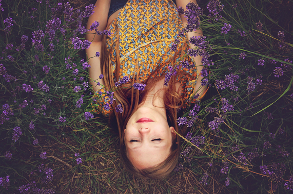 woman laying in a lavender field, CranioSacral (CST) therapy