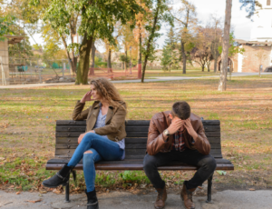 couple sitting on a bench in a park, turned away from each other, 10 Buckets for Work Life Balance: #6 Relationship with Partner and Others – Give and Receive Love