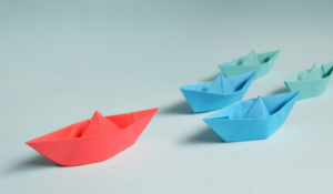 one red, two blue and two green boats folded out of paper, 4 Easy Ways to Make Your Business Growth a Reality