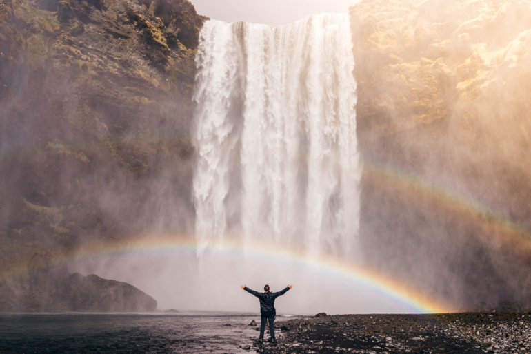 man dressed in front of a waterfall and a rainbow, 10 Buckets for Work Life Balance: #2 How to Change Your Belief System – How You Were Parented – Reparenting with Inner Child Work – Become Your Own Parent