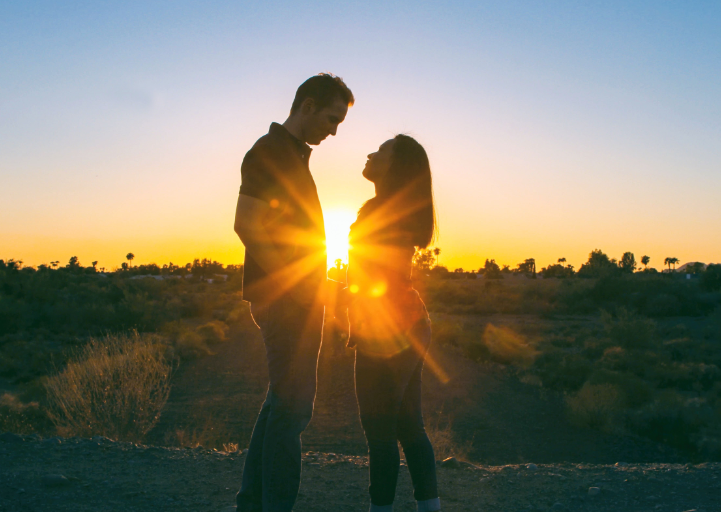 couple standing in the sunset, looking at each other, learn how to build relationships with Heather's 10 Buckets for Work Life Balance: #6 Relationship with Partner and Others – Give and Receive Love