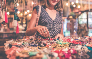 female customer looking through the offered goods, 4 Easy Ways to Make Your Business Growth a Reality