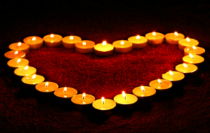 burning tea candles shaping a heart, making a decision about c section or natural birth