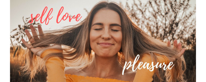 woman with long brown hair and orange pullover, letting her hands slide through her hair, how your fear of intimacy makes your relationship fail and 5 ways to overcome your fears