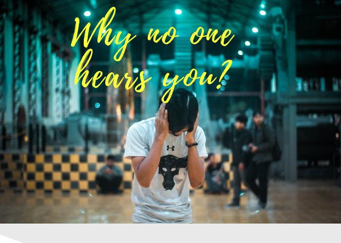 a young adult with black hair holding his hands over his ears, Why No One Hears You: Mindfulness and Intention