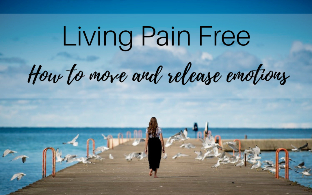 woman with long brown hair, shirt, and long skirt is walking over a wooden pier toward the ocean, Living Pain Free: How to Move and Release Emotions