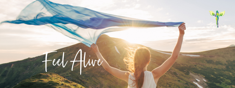 woman holding her scarf in the wind in front of a mountain, Experience Joy and Pleasure to Feel Alive