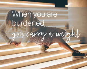 woman on the stairs in pain, when you are burdened, you carry a weight, setting boundaries helps to avoid physical pain