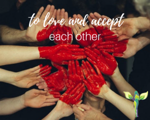 many hands together with a red heart