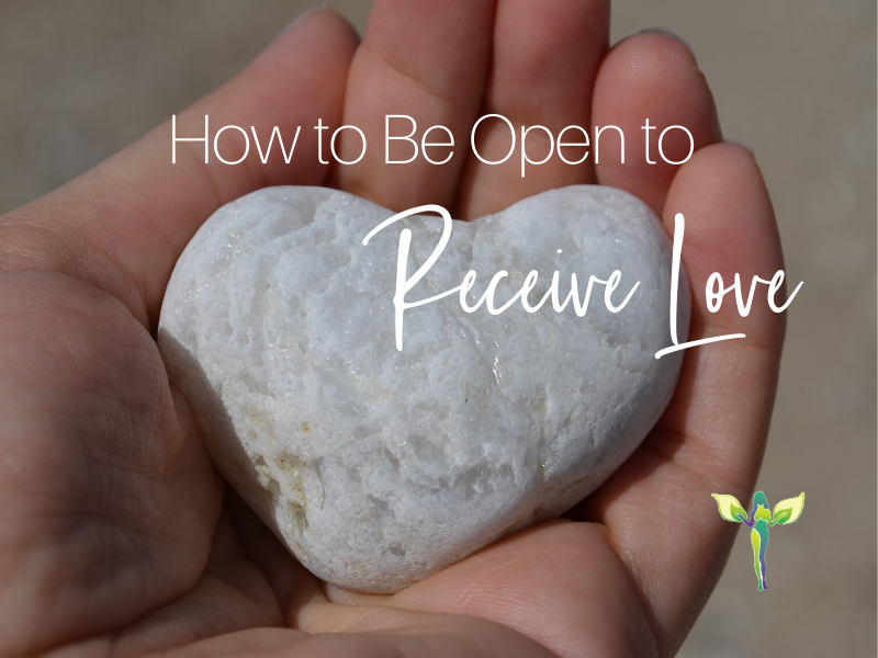 heart shaped rock in a hand, how to be open to receive love and support